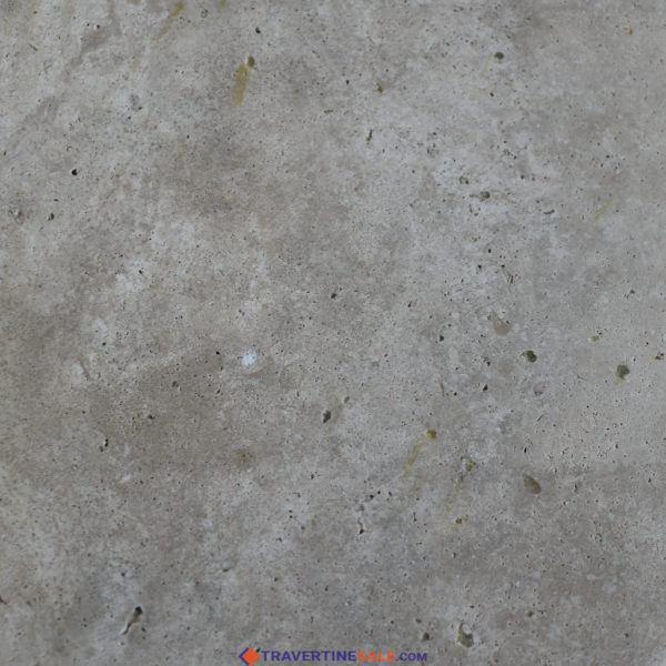 classic cross cut travertine tile surface with honed and filled finish with beige color