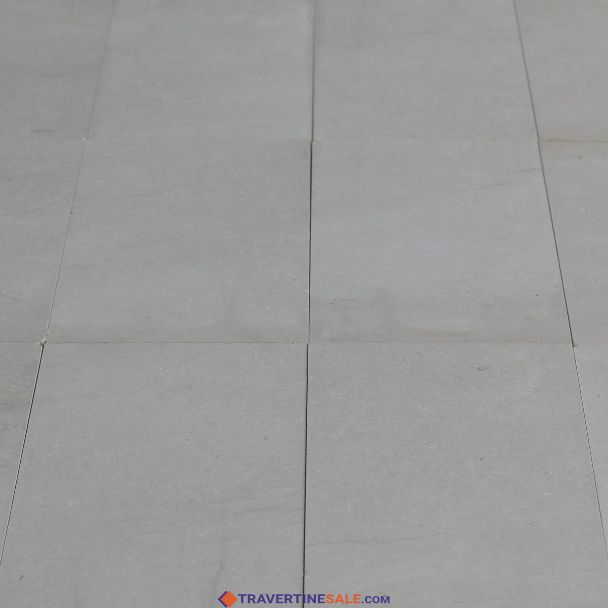 perla bianco limestone tiles surface with honed and filled finish and white background