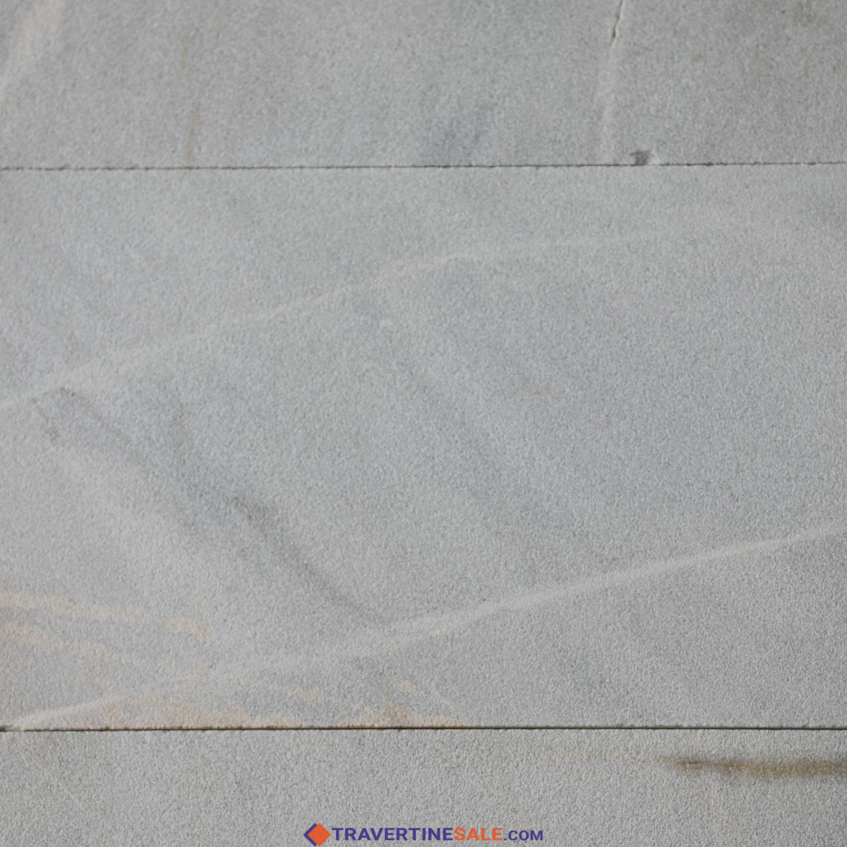 30,5x61 sandblasted ice white gold marble pavers with white background and gold veins close up