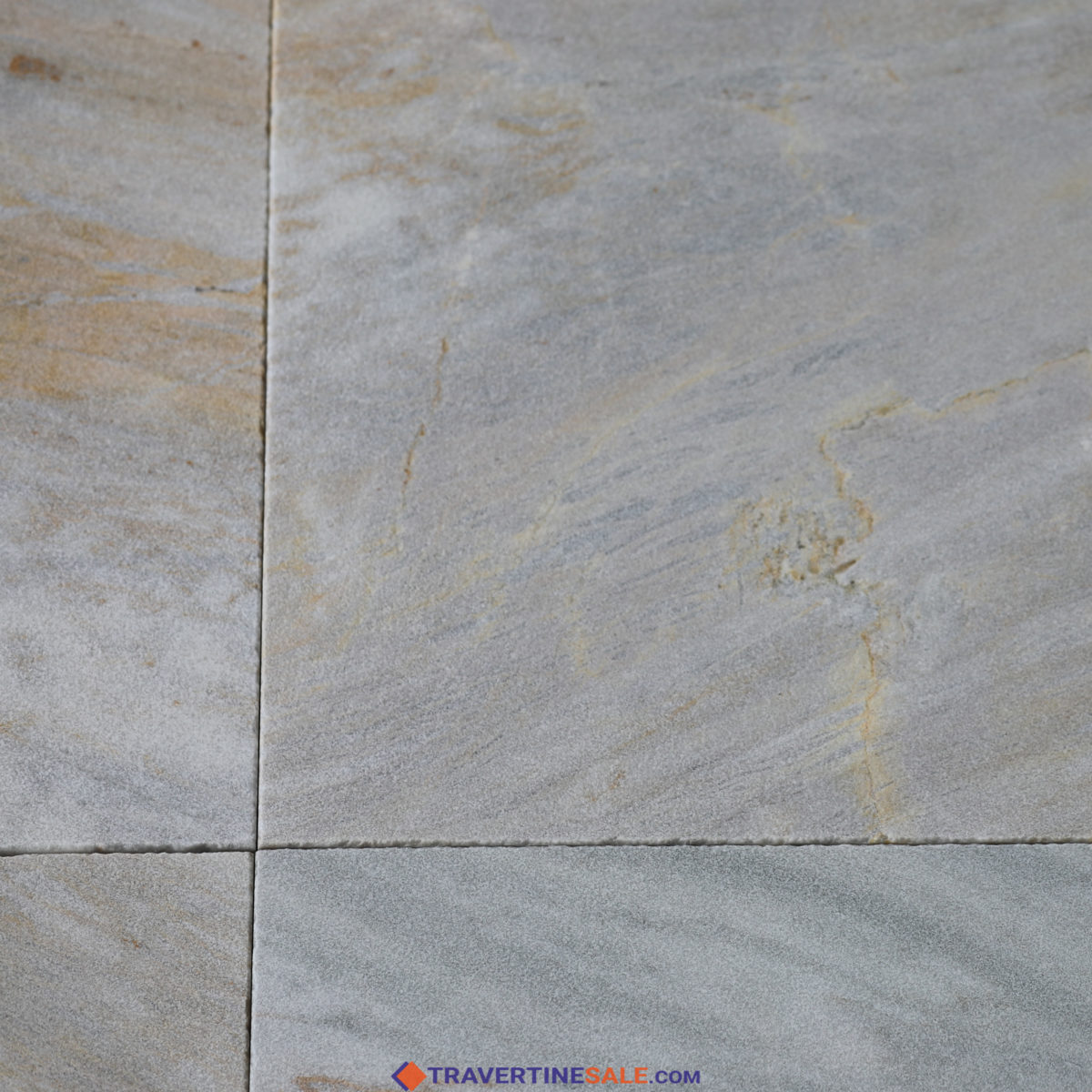 40,6x61 sandblasted ice white gold marble pavers with white-gray background and gold veins close up