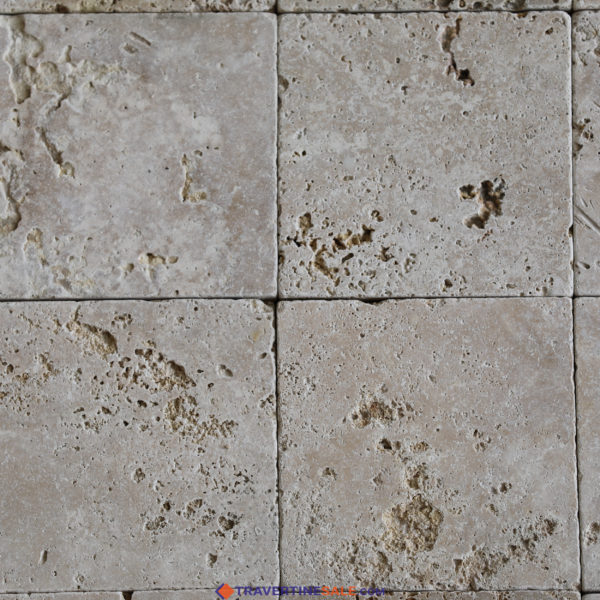 commercial classic travertine tiles surface with tumbled finish and light beige background