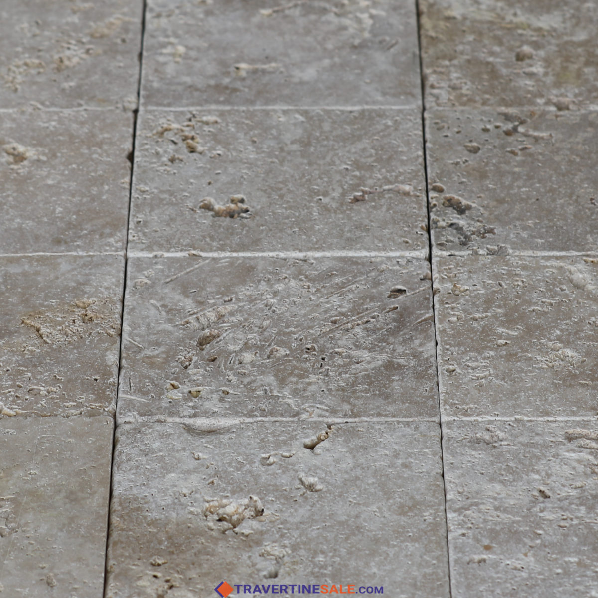 commercial travertine tiles with tumbled finish and light beige background