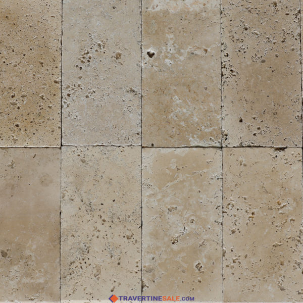 ivory travertine tiles with tumbled finish and ivory background