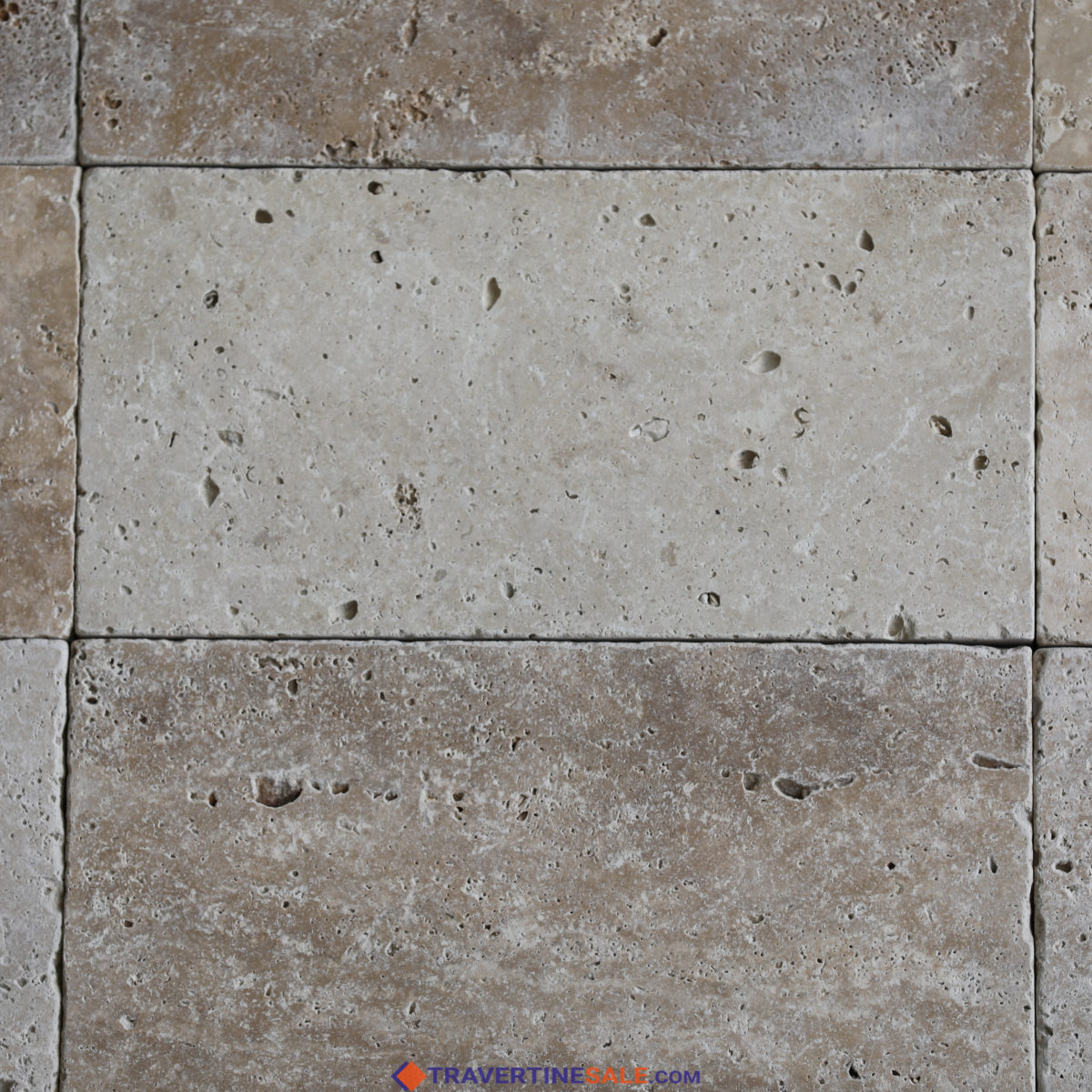 ivory travertine tiles with tumbled finish and ivory background dry and close up