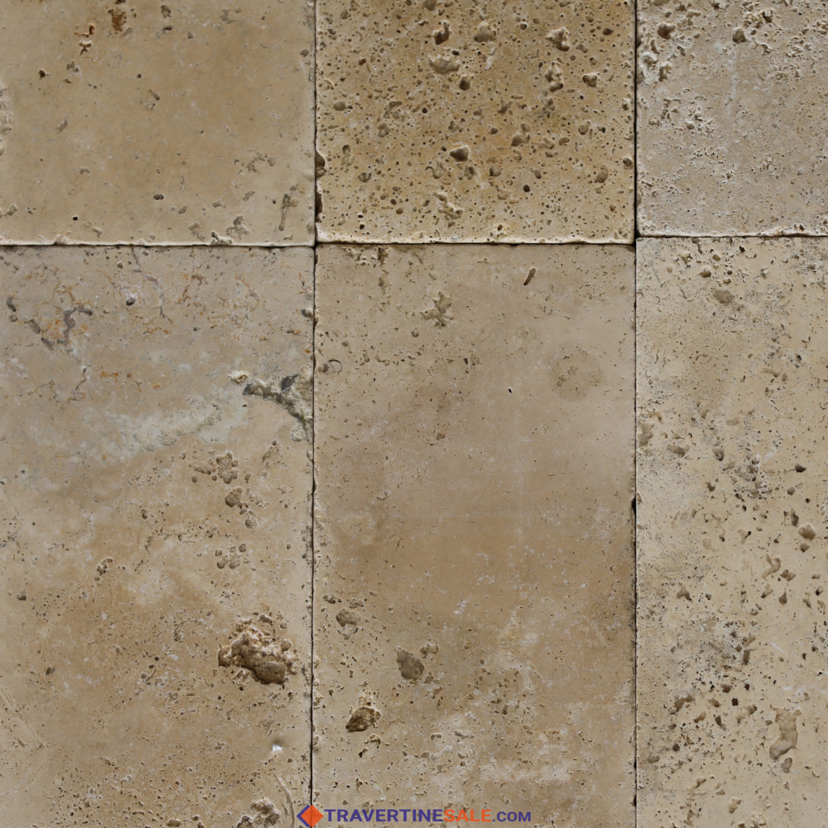 ivory travertine tiles surface with tumbled finish and beige background