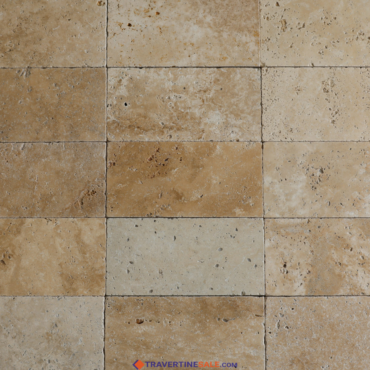 ivory travertine tiles with tumbled finish and beige background wet