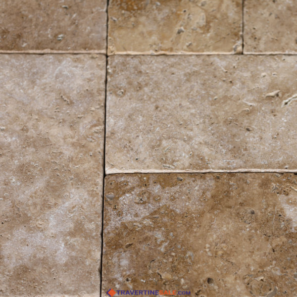 tumbled noche travertine pavers surface with dark beige background