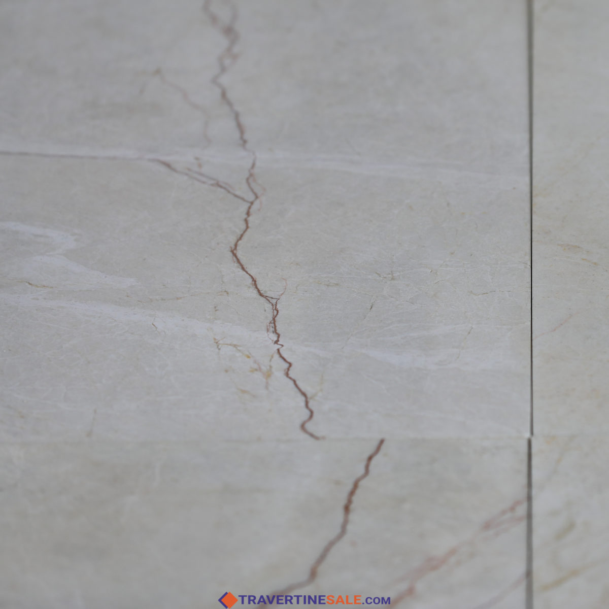 polished close up vanilla marble tile surface with beige color and red veins