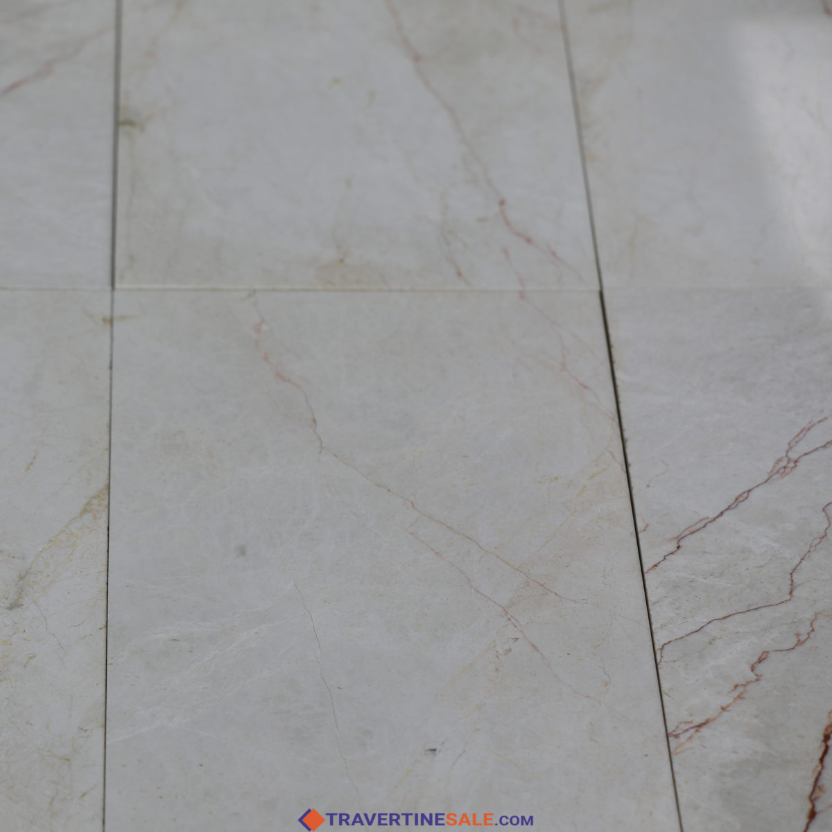 polished close up vanilla marble tiles with beige background and red veins