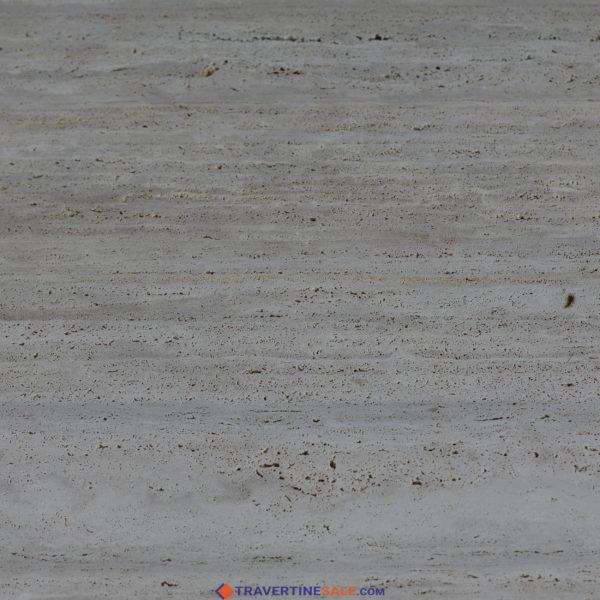 veincut classic travertine with raw finish surface and beige background and dark beige veins